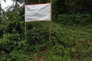 The Water Project: Lugango Community, Lugango Spring -  Caution Chart On Covid Installed At The Spring