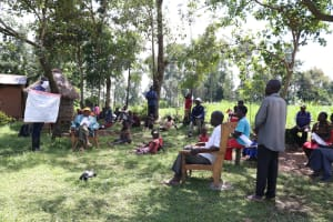 The Water Project: Sambaka Community, Sambaka Spring -  Sir Erick Shows The Prevention Reminders Chart