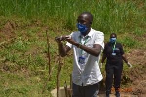 The Water Project: Emukoyani Community, Ombalasi Spring -  Trainer Protus Demonstrates Handwashing