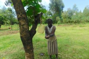 The Water Project: Ataku Community, Ngache Spring -  Handwashing Demonstration By Irine The Water Committee Chair