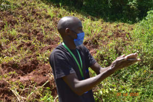 The Water Project: Emulembo Community, Gideon Spring -  Protus Demontrating Handwashing