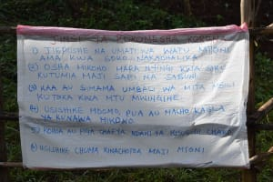 The Water Project: Ibinzo Community, Lucia Spring -  Caution Chart With Prevention Reminders