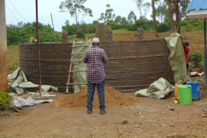 The Water Project: Jinjini Friends Primary School -  Removing Sacks From Outer Walls