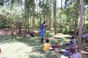 The Water Project: Shirugu Community, Shapaya Mavonga Spring -  Facilitator Shows Better Method Of Sneezing