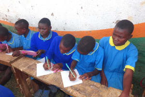 The Water Project: St. Michael Mukongolo Primary School -  Students Take Notes At Training