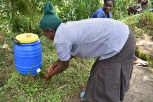 The Water Project: Ingavira Community, Laban Mwanzo Spring -  Handwashing Demonstration