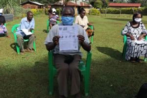 The Water Project: Shirakala Community, Ambani Spring -  A Gent Posing With The Manual