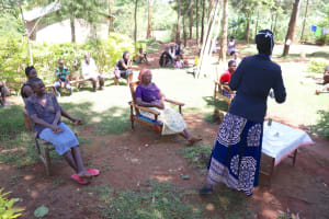 The Water Project: Chegulo Community, Yeni Spring -  Keen Community Members Listening In