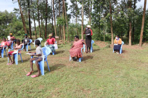 The Water Project: Ematetie Community, Weku Spring -  A Participant Asking For Clarification