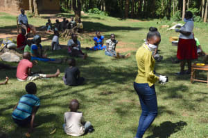 The Water Project: Munenga Community, Burudi Spring -  Trainer Betty Helped Arrange People Into Safe Social Distancing