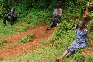 The Water Project: Shikhombero Community, Atondola Spring -  Staff Protus And Community Members Listening