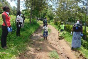 The Water Project: Eshiakhulo Community, Asman Sumba Spring -  Demonstrating Social Distancing