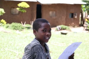The Water Project: Shirugu Community, Shapaya Mavonga Spring -  A Girl Reacting To A Comment By A Community Member