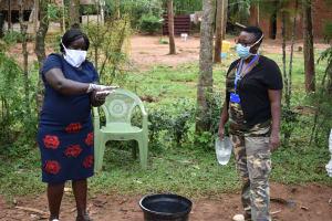The Water Project: Musango Community, Emufutu Spring -  Handwashing Demonstration By Team Leader Catherine Chepkemoi