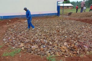 The Water Project: Jinjini Friends Primary School -  Laying Wire On Foundation