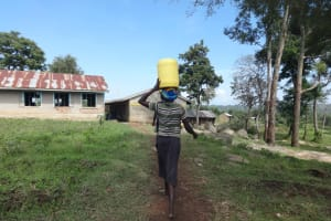 The Water Project: St. Michael Mukongolo Primary School -  Parents Bring Water From The River For Construction Work