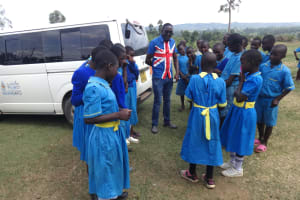 The Water Project: St. Michael Mukongolo Primary School -  A Facilitator Joins A Group Discussion
