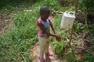 The Water Project: Emukoyani Community, Ombalasi Spring -  Demonstrating Handwashing