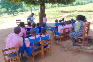 The Water Project: Kapsaoi Primary School -  A Pupil Presents Work From His Group