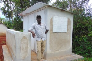 The Water Project: Gamalenga Primary School -  The Deputy Head Teacher Poses With The Latrines