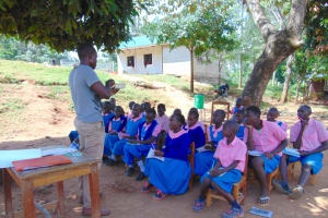 The Water Project: Kapsaoi Primary School -  Trainer Samuel Explains Solar Disinfection