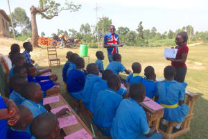 The Water Project: St. Michael Mukongolo Primary School -  Trainer Carolyne Teaches Hygiene And Sanitation Using Diagrams