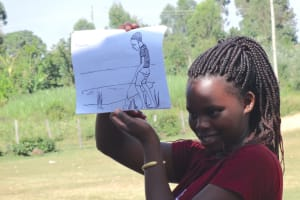 The Water Project: St. Michael Mukongolo Primary School -  Carolyne Leads Discussion On Open Defecation And Urination Using Diagram