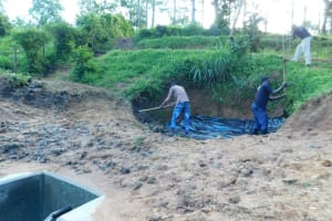 The Water Project: Shikangania Community, Abungana Spring -  Backfilling With Soil