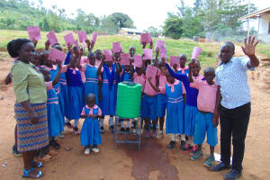 The Water Project: Kapsaoi Primary School -  Pupils With Training Materials Teacher And Trainer Victor