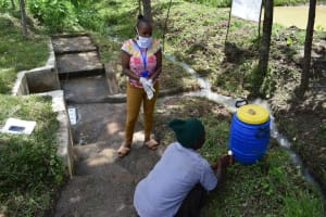 The Water Project: Ingavira Community, Laban Mwanzo Spring -  Handwashing Practice Demonstration