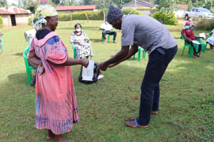 The Water Project: Shirakala Community, Ambani Spring -  A Gent From The Community Demostrating Handwashing