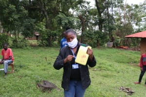 The Water Project: Malava Community, Ndevera Spring -  The Facilitator Making A Leaky Tin