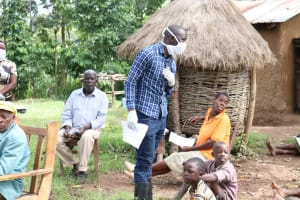 The Water Project: Sambaka Community, Sambaka Spring -  Trainer Erick Listens To A Question From A Participant