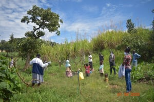 The Water Project: Bukhanga Community, Indangasi Spring -  Water Users And Staff Listen To Emmah