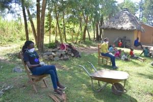 The Water Project: Munenga Community, Burudi Spring -  Training Team Listening In