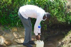 The Water Project: Eshiakhulo Community, Kweyu Spring -  Trainer Protus Preparing The Leaky Tin