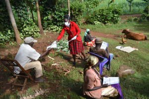 The Water Project: Ibinzo Community, Lucia Spring -  Passing Out Informational Pamphlets