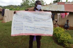 The Water Project: Irungu Community, Irungu Spring -  Chart Use At The Training