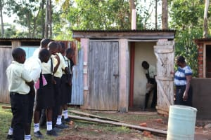 The Water Project: St. Gerald Mayuge Secondary School -  Latrine Disinfection Practical With Ash