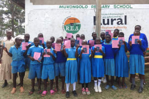 The Water Project: St. Michael Mukongolo Primary School -  Students Pose For A Picture Witb Training Booklets