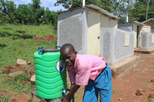 The Water Project: Kapsaoi Primary School -  Pupil Handwashing After Visiting Toilet