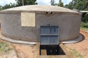 The Water Project: Kapsaoi Primary School -  Completed Rain Tank With Flowing Water