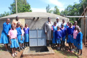 The Water Project: Kapsaoi Primary School -  Pupils Teachers And Staff Pose At Rain Tank