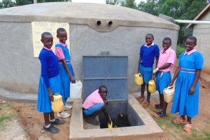 The Water Project: Kapsaoi Primary School -  Fetching Water From The Rain Tank