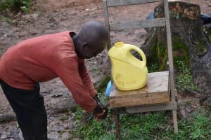 The Water Project: Maganyi Community, Bebei Spring -  He Did The Handwshing So Well
