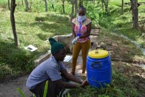 The Water Project: Ingavira Community, Laban Mwanzo Spring -  Handwashing Station In The Community
