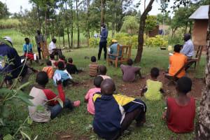 The Water Project: Sambaka Community, Sambaka Spring -  Sir Erick Leading The Session