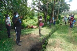 The Water Project: Mungakha Community, Asena Spring -  Facilitators In Masks Lead Training