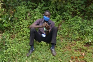 The Water Project: Shikhombero Community, Atondola Spring -  Trainer Protus Listening Keenly