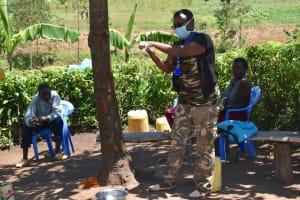The Water Project: Musango Community, M'muse Spring -  Proper Handwashing Demonstration